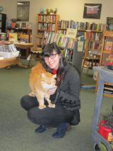 Monty the Thumb-cat Greets a NewCustomer